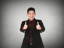 Asian business man show thumb up Stock Photo