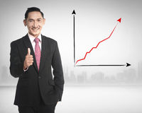Asian business man show thumb up. Because sales increasing Stock Images