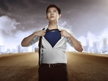 Asian business man showing a superhero suit Royalty Free Stock Photo