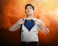 Asian business man showing a superhero suit Royalty Free Stock Photography