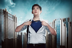 Asian business man showing a superhero suit Royalty Free Stock Image