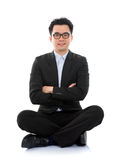 Asian business man sitting on floor Stock Photo