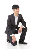 Asian business man squat Royalty Free Stock Photography