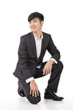Asian business man squat Stock Image