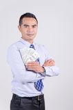 Asian business man standing and holding money dollar in his hand Royalty Free Stock Image