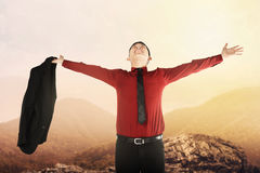 Asian business man standing on the mountain Stock Photography