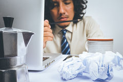 Asian Business man stressed. Business man stressed and under pressure, selective focus royalty free stock image