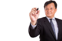 Asian business man in suit writing with marker pen Stock Images