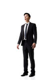 Asian business man surprised. With outrageously and funny pose, full length portrait isolated Royalty Free Stock Photos