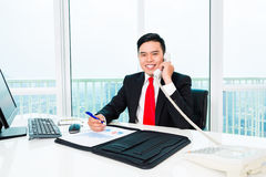 Asian business man telephoning in office Stock Images