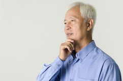 Asian business man thinking Stock Photo