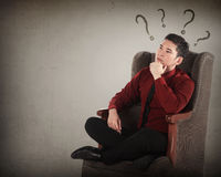 Asian business man thinking on armchair Royalty Free Stock Image