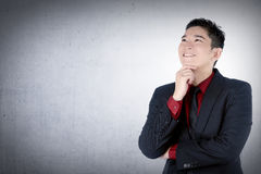 Asian business man thinking Royalty Free Stock Images