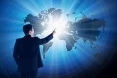 Asian business man touching world on virtual screen. Globalization business concept Royalty Free Stock Images