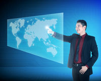 Asian business man touching world on virtual screen Stock Image