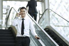 Asian Business man using a Cell Phone Stock Images