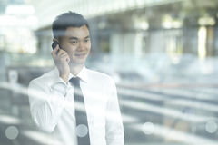 Asian Business man using a Cell Phone Stock Photography