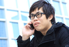 Asian Business man using a Cell Phone Stock Photo