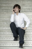 Asian Business man using a Cell Phone Royalty Free Stock Image