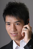 Asian business man using cellphone Royalty Free Stock Images