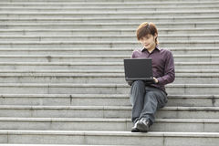 Asian Business man using a Digital Tablet Stock Images