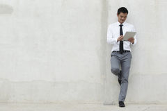 Asian Business man using a Digital Tablet Stock Photography