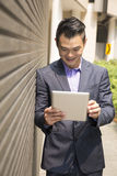 Asian business man using digital tablet. Stock Images