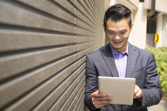 Asian business man using digital tablet. Royalty Free Stock Photos