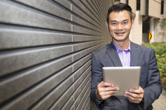 Asian business man using digital tablet. Stock Photos