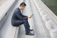 Asian business man using digital tablet. Stock Photography