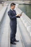 Asian business man using digital tablet. Stock Image