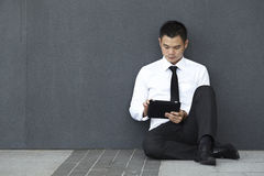 Asian Business man using an iPad Stock Photos