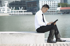 Asian Business man using an iPad Stock Images