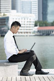 Asian Business man using an iPad Stock Photo