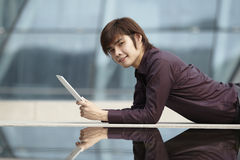 Asian Business man using an iPad Royalty Free Stock Photography
