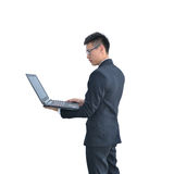 Asian Business man using laptop computer isolated on white backg Royalty Free Stock Images