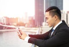 asian business man using smart phone royalty free stock photos