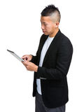 Asian business man using tablet Royalty Free Stock Images