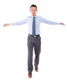 Asian business man walking balance Stock Images