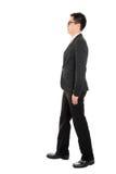 Asian business man walking Royalty Free Stock Photos