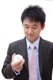 Asian Business man watch ball Stock Photo