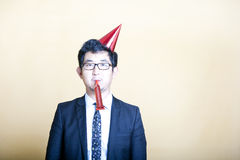 Asian business man wearing party hat Stock Image