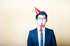 Asian business man wearing party hat Royalty Free Stock Images