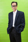 Asian business man wearing western suit standing with relaxing e Stock Images