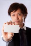 Asian business man with white card Royalty Free Stock Image
