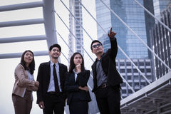Asian business man and woman group standing on ground and to poi. Asian business men and women group standing on ground and to point the finger away and business Stock Image