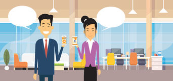 Asian Business Man And Woman Hold Cell Smart Phone Chat Bubble In Modern Office Royalty Free Stock Image