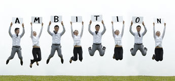 Asian business man & woman jumping with a sign Stock Images