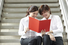 Asian Business man and woman reading a document Royalty Free Stock Photo