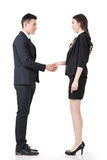Asian business man and woman shake hands Stock Photo